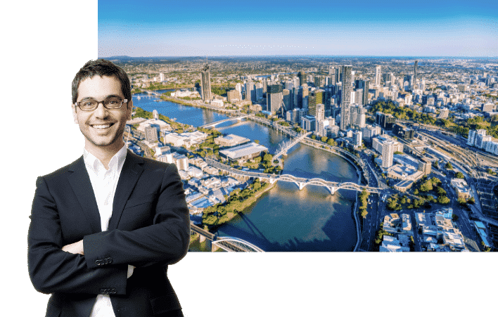 Conveyancing lowyers Brisbane - happy conveyancing solicitor standing behind an image of Brisbane QLD